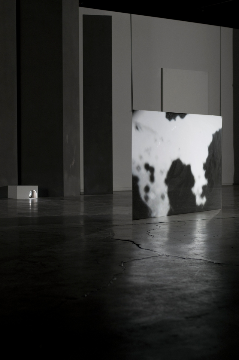 "Installation at ""Six:"" Try-Me Gallery, Richmond, VA. Video is rear-projected onto suspended acrylic projection sheeting."